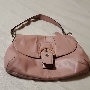 Pink Coach bag buckle in front, short strap,pretty